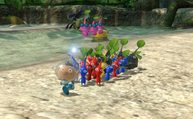 Pikmin 3 Deluxe Alph leading a group of colourful Pikmin
